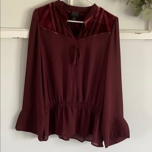 Wine-colored blouse with velvet and tie detail